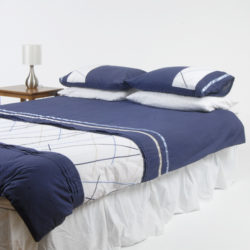 Queen bed with a blue doona cover